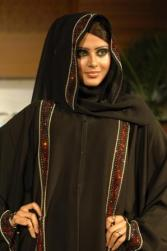 Saudi woman wearing embroidered thawb